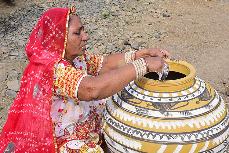 A woman from Pokharan giving final touch to pot
