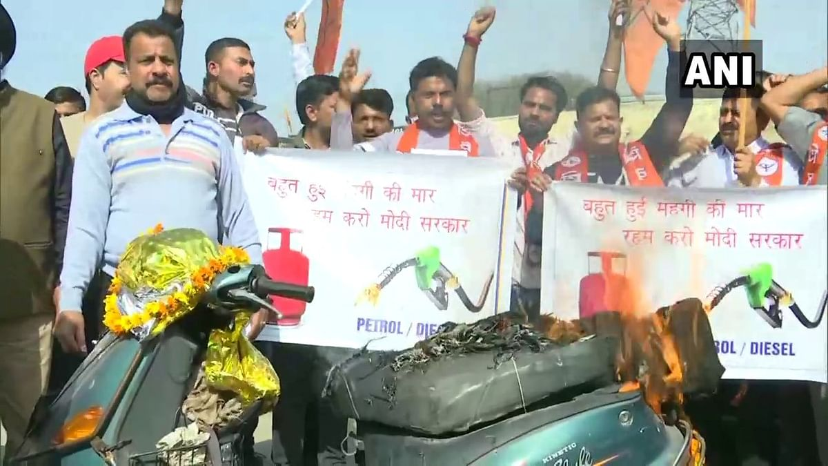 Jammu and Kashmir: Shiv Sena leaders set scooty on fire during protest against fuel price hike