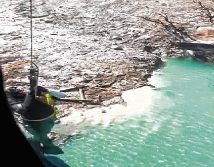 Naval divers measure the depth of the glacial lake formed 5 km  upstream of Tapovan on Sunday.