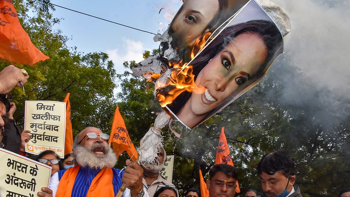 United Hindu Front supporters burn posters of international activists and celebrities, who supported the ongoing farmers protest against the new farm laws, at Jantar Mantar in New Delhi