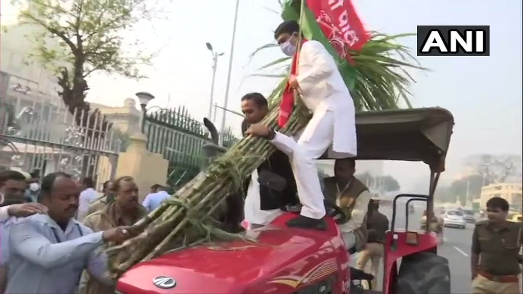 Lucknow: Samajwadi Party legislators reach Vidhan Bhawan on tractors to protest against farm laws