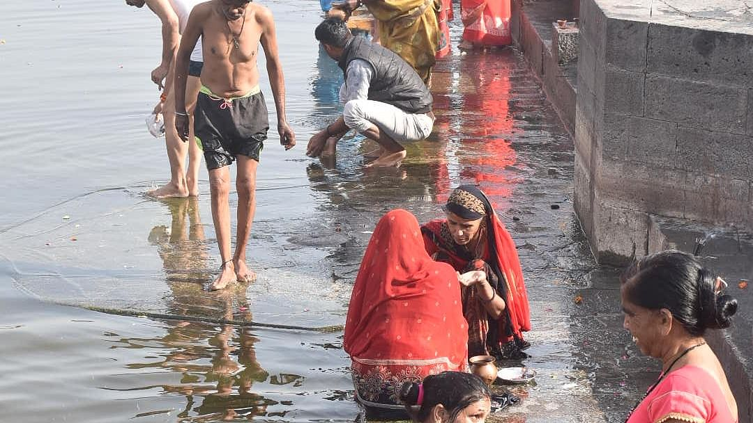 Devotees taking dips at dirty ghats