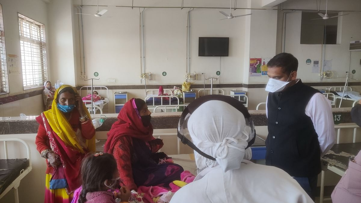 Collector interacts with patients at Charak Hospital