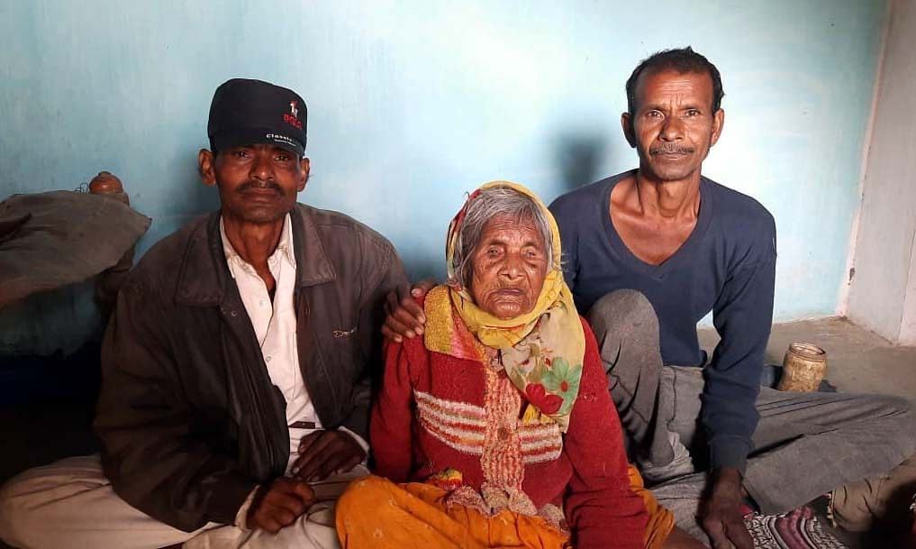 120-year-old Kemli Mallah  with her family at her home in Karahiya village, Rewa district