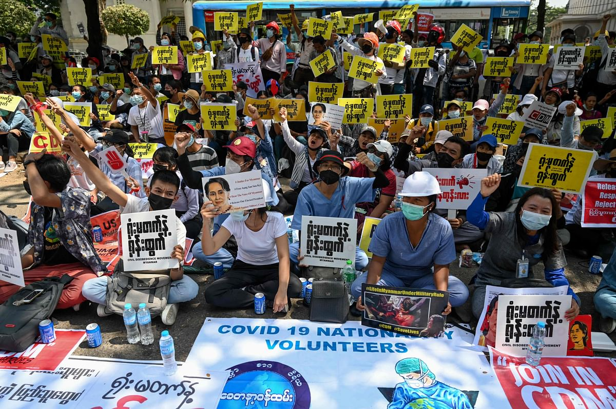 Protesters shout slogans during a demonstration against the military coup in front of the Myanmar Economy Bank in Yangon on February 16, 2021.