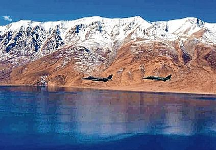 Indian Air Force ground attack aircraft Jaguar are seen flying along the Northern Frontiers in Leh on Sunday.
