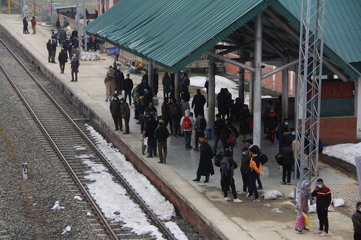 Passengers waiting for a train as the rail service connecting Banihal to Baramulla resumed, in Kashmir on Monda. After remaining suspended for 11 months due to the pandemic