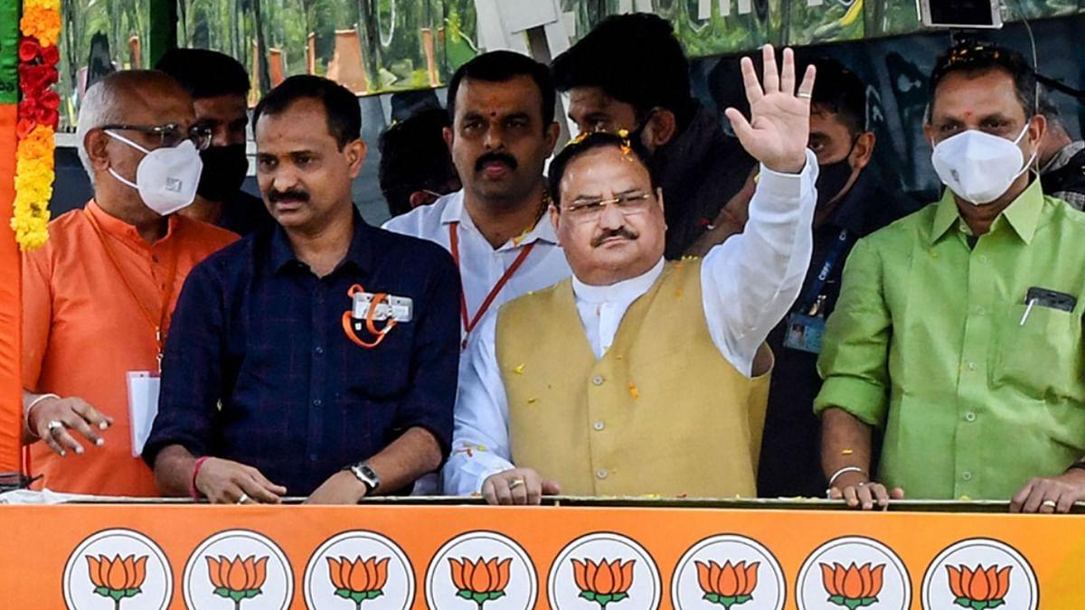 BJP National President JP Nadda waves at the crowd during his roadshow, in Thiruvananthapuram, Wednesday, Feb 3, 2021.
