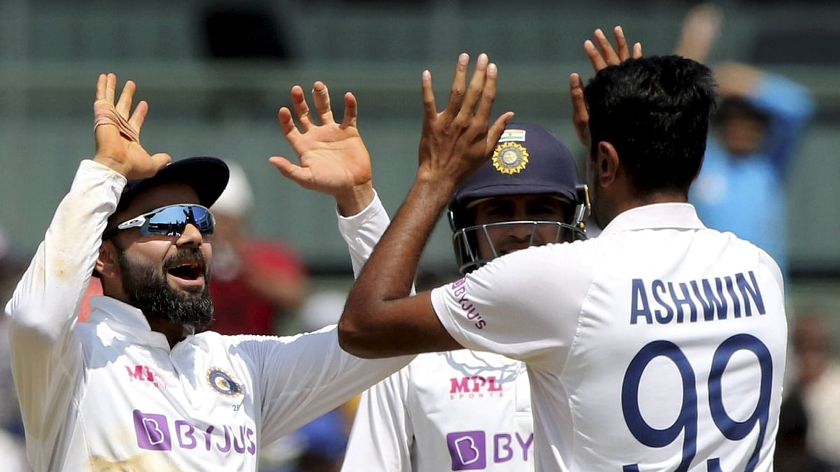 R Ashwin celebrates with Virat Kohli after taking the wicket of England's Ben Stokes during the 2nd day of second Test at MA Chidambaram Stadium, in Chennai