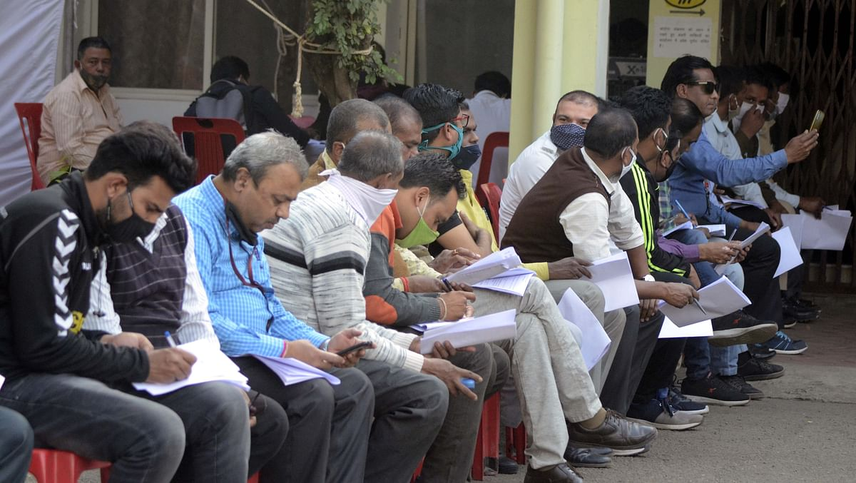 8pic Holding consent forms, FLWs wait for their turn for vaccination at Protima Lady Hospital, on Thursday.