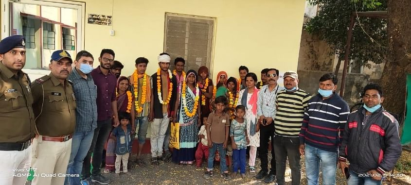 Villagers who were brought back by Khargone from Beed, Maharashtra on Monday