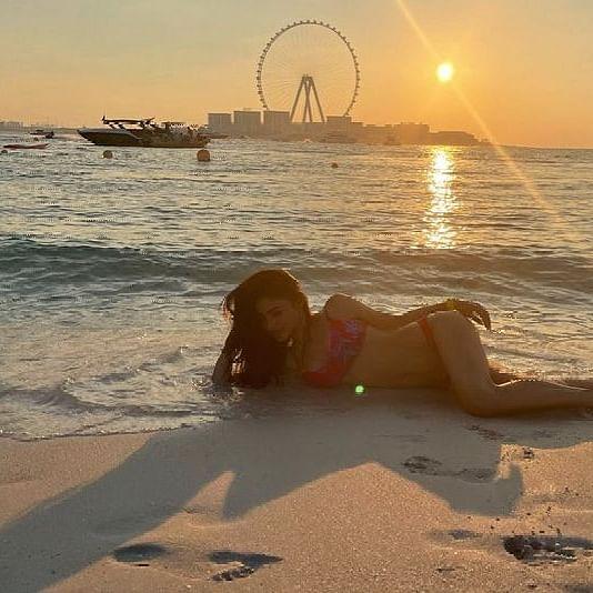Mouni Roy looks ravishing in a hot red bikini as she enjoys a day at the beach