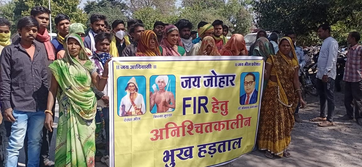 Tribals protest outside police station in Sardarpur on Friday