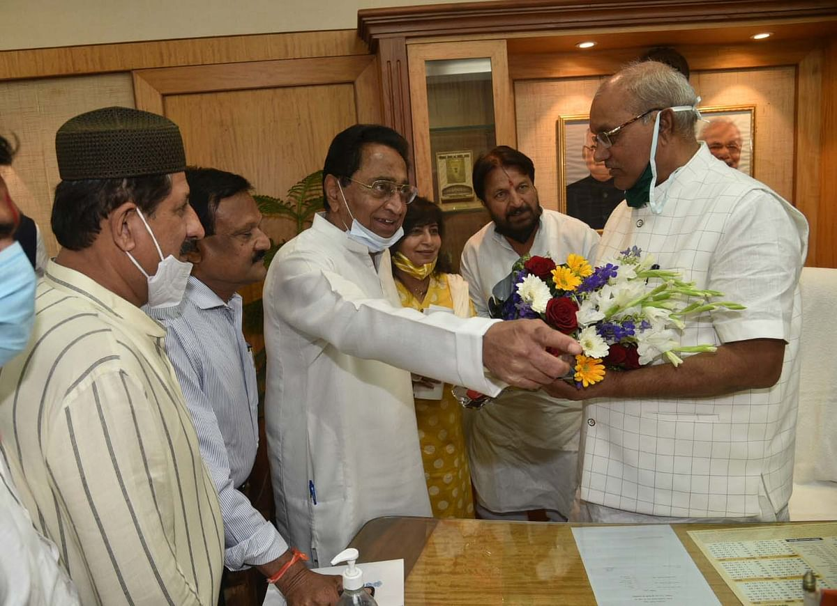Leader of Opposition Kamal Nath congratulates Girish Guatam on being elected as Vidhan Sabha Speaker unopposed on Monday.