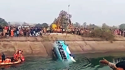 NDRF team carries out rescue operations after an bus plunged into a canal in Sidhi district.File pic