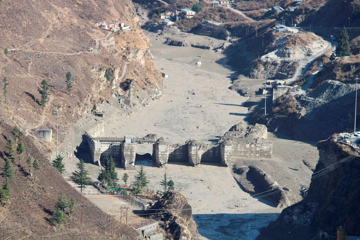 Damaged Dhauliganga hydropower project after a glacier broke off in Joshimath causing a massive flood in the Dhauli Ganga river, in Chamoli district of Uttarakhand, Sunday, Feb. 7, 2021.