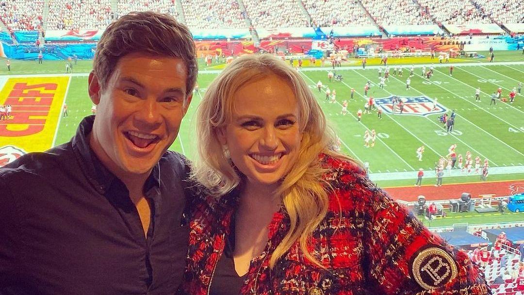 Super Bowl 2021: Rebel Wilson throws shade at ex-beau Jacob Busch by posing alongside Adam Devine