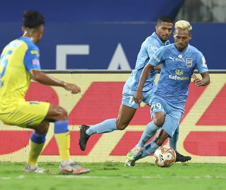 Mumbai City's Bipin Singh (R) in action during the match