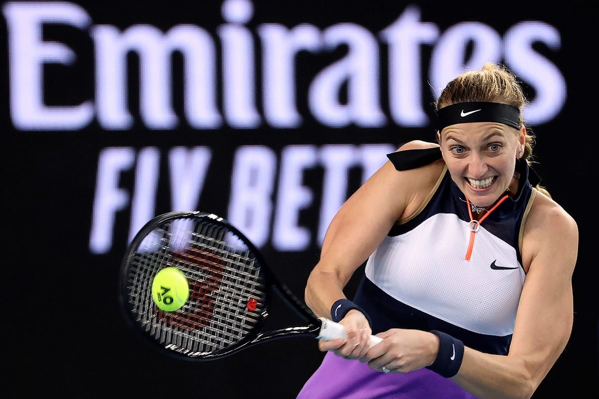 Czech Republic's Petra Kvitova hits a return against Belgium's Greet Minnen during their women's singles match on day one of the Australian Open tennis tournament in Melbourne on Monday