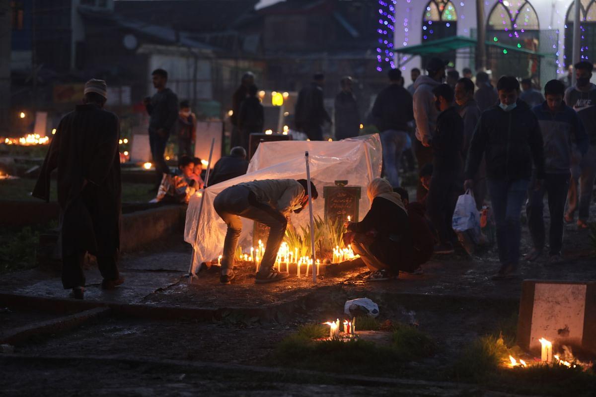 Kashmiri Shiite Muslims illuminate graves of their relatives during the Muslim festival of Shab-e-Barat in Srinagar, Kashmir.