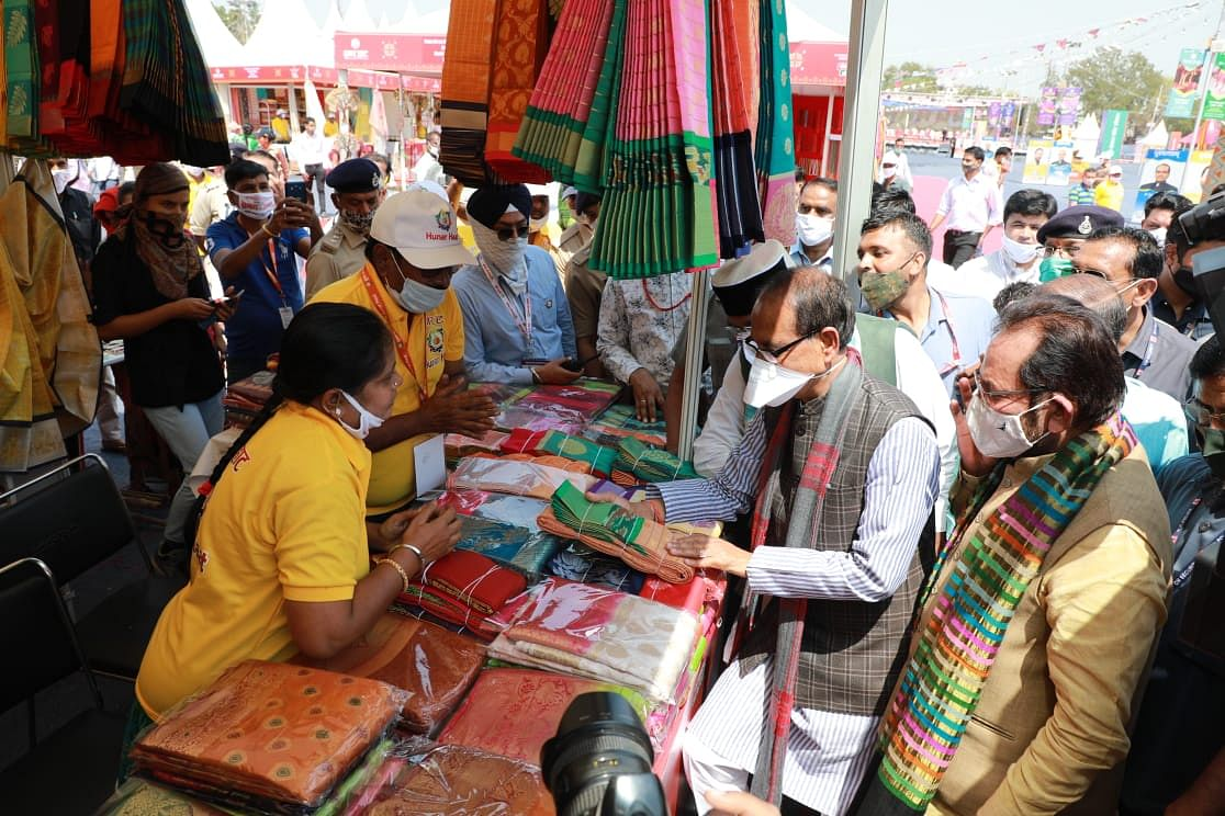 Chief minister Shivraj Singh Chouhan, Union Minister for Minority Affairs Mukhtar Abbas Naqvi look at products at Hunar Haat