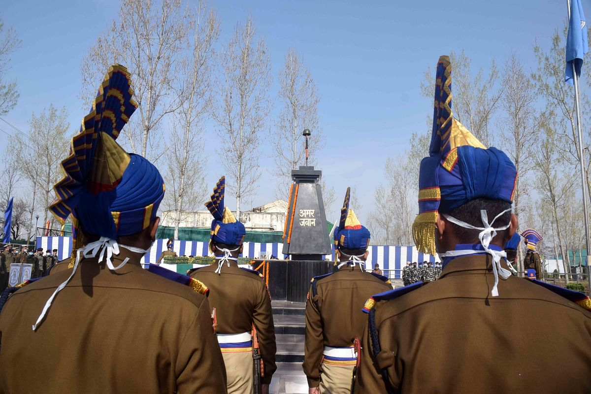 CRPF personnel pay tribute to their two colleagues, who were killed in a militant attack at Pampore yesterday, during a wreath laying ceremony at Humahama on the outskirts of Srinagar.