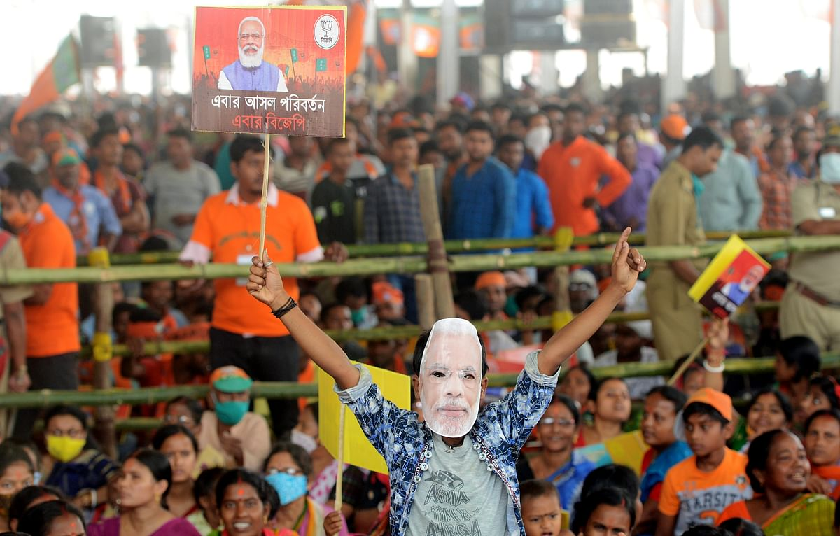West Bengal, March 24 (ANI): BJP supporters during Prime Minister Narendra Modis speech at an election campaign rally at Kathi in East Midnapore on Wednesday.