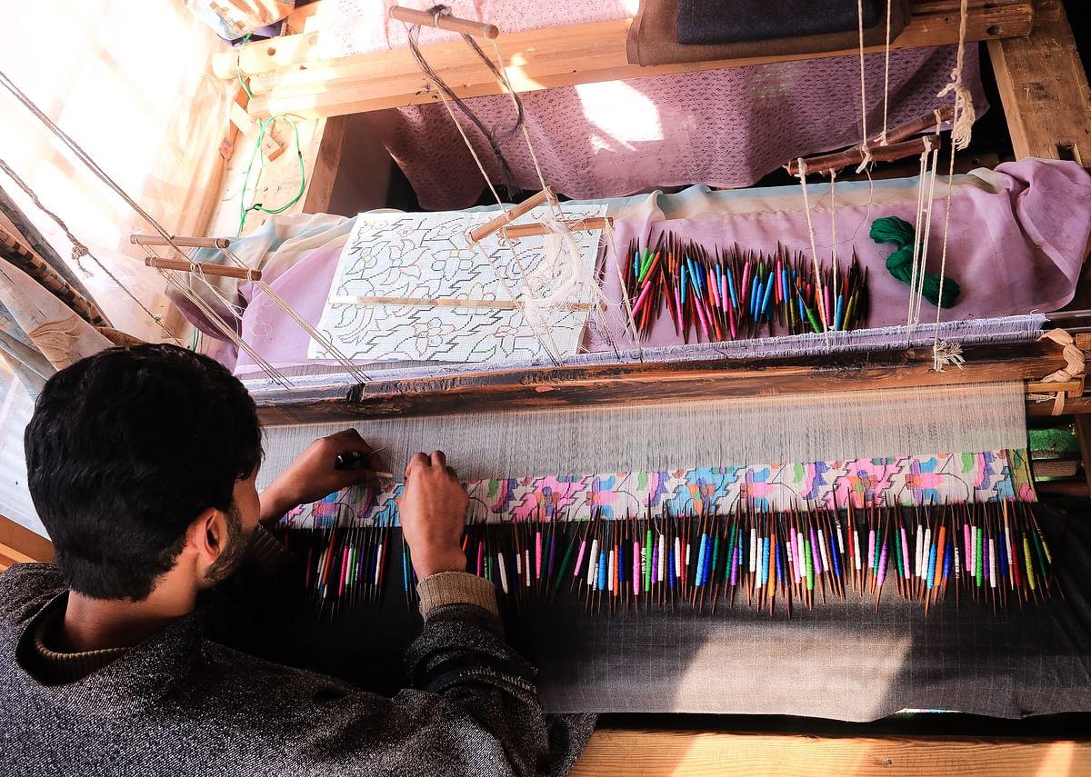 Kashmiri artisan weaves Kani Shawl, woven from Pashmina yarn, at a village in Budgam district in West Srinagar city.