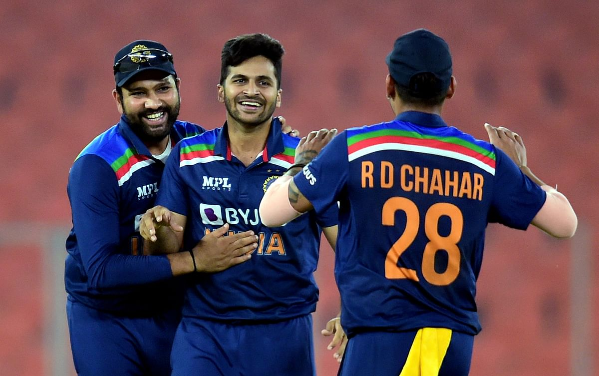 Ahmedabad: Indian bowler Shardul Thakur (C) with team celebrates the wicket of England batsman Eoin Morgan during the fourth Twenty20 match between India and England, at Narendra Modi Stadium in Ahmedabad, Thursday, March 18, 2021.