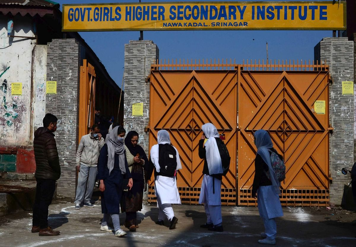 Students arrive at a school after a gap of nearly one year, following COVID-19 safety guidelines issued by the government, in Srinagar, Monday, March 1 , 2021. All the educational institutes including schools, colleges and universities in J&K, which were closed in March last year in wake of the COVID-19 outbreak.