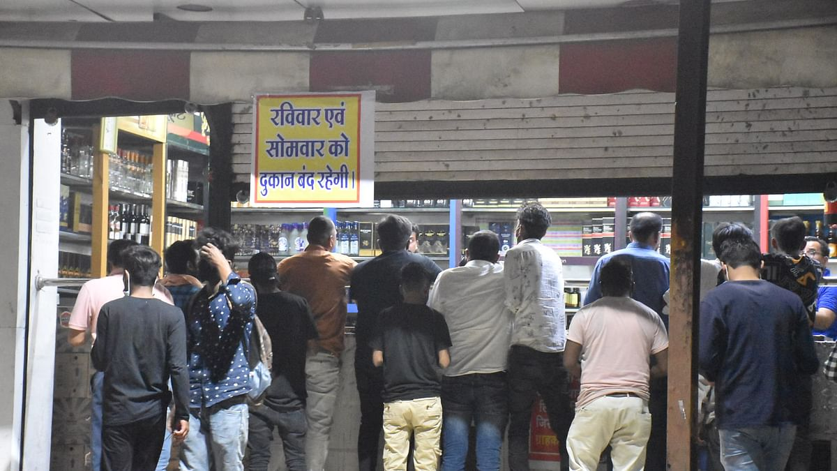 Booze lovers at a foreign-made liquor shop on the eve of two-day's dry day