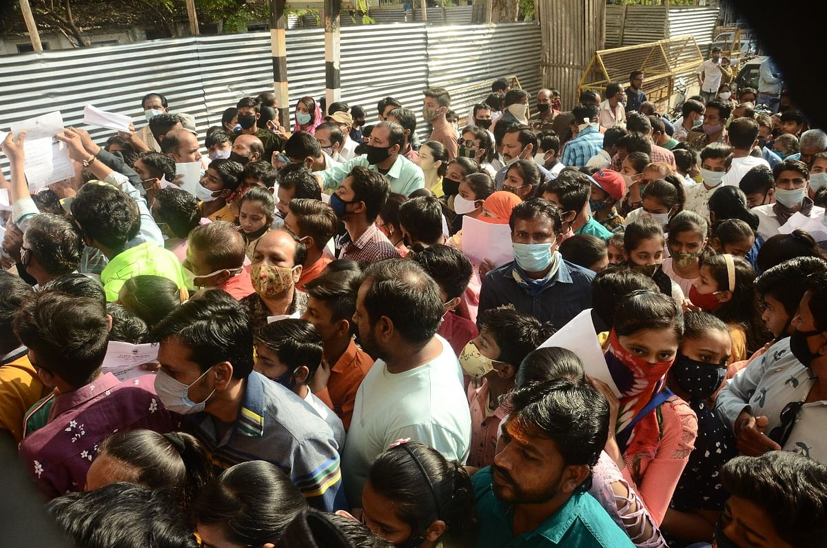 WHO CARES? Students flout social distancing during entrance examination for the School of Excellence, in Ujjain on Sunday
