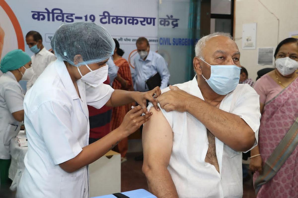 A senior citizen receives a jab