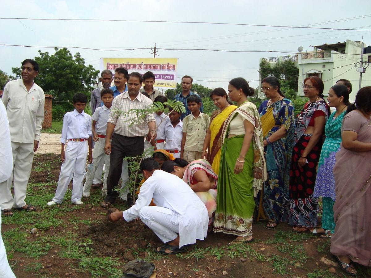 Members of Kunjal Welfare Society plant saplings