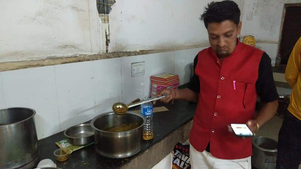 One of two employees cooking chicken in Guna Hospital mess