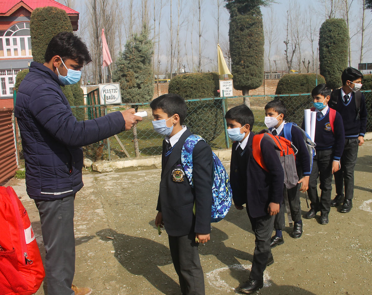 Primary school students being thermal screened on the first day of schools reopening for them after the Covid-19 induced closure, on March 15, 2021 in Srinagar, Kashmir.