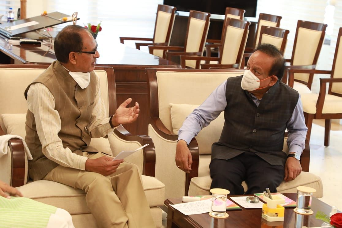 Chief minister Shivraj Singh Chouhan with union health minister Harsh Vardhan at CM residence in Bhopal on Sunday