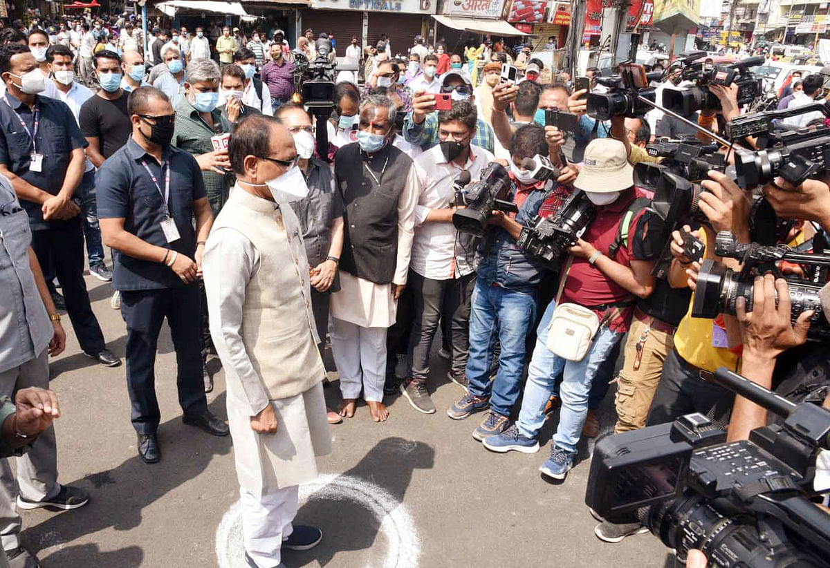 Madhya Pradesh Chief Minister Shivraj Singh Chouhan observes two-minute silence during the launch of a statewide campaign My Mask My Security to sensitize people regarding the coronavirus safety norms in Bhopal on Tuesday.