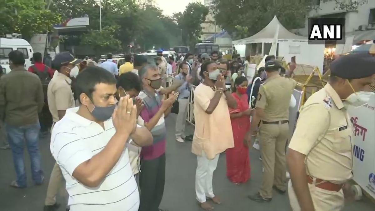 COVID-19: Devotees offer prayers outside Siddhivinayak Temple in Mumbai on Ganesh Angarki Chaturthi - See photos