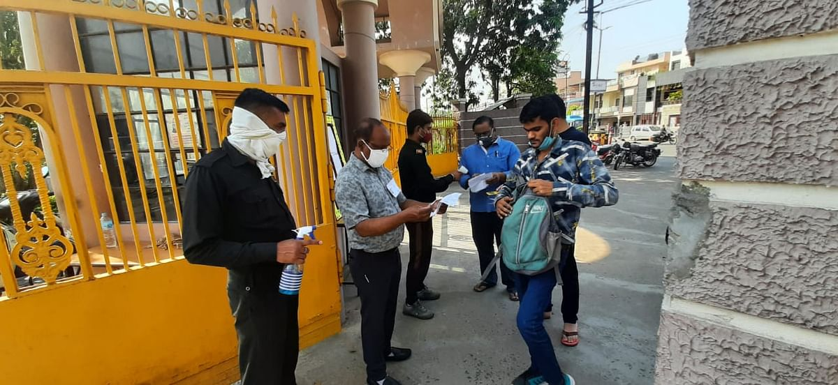 MPPSC exam candidate's papers being checked at examination centre set up at Sarafa Vidya Niketan in Indore on Sunday morning