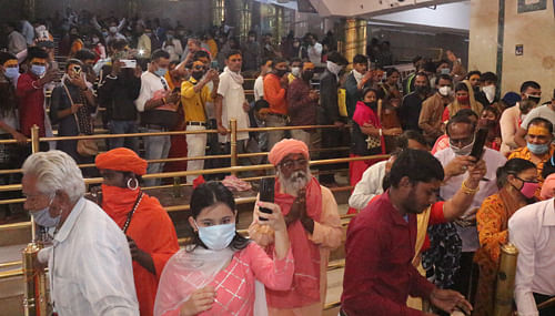 Devotees wait for their turn to pay obeisance to Lord Mahakal