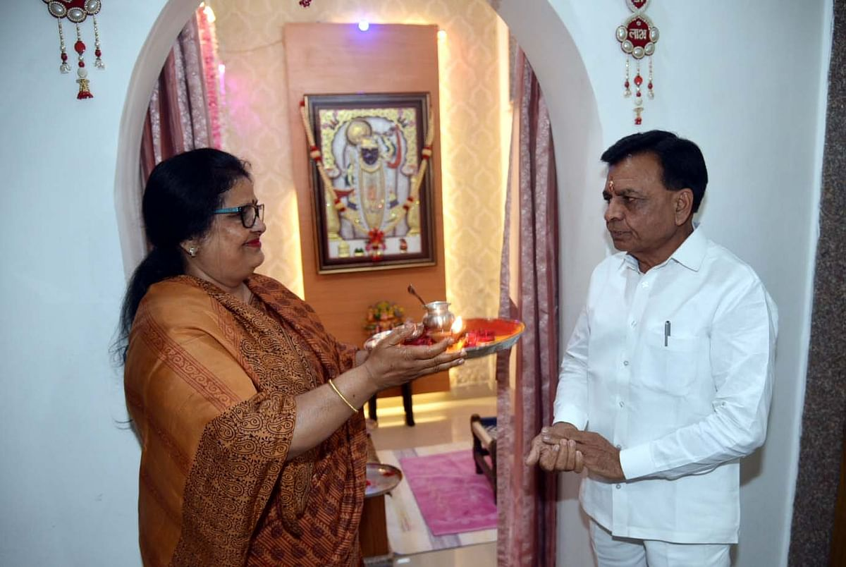 Wife offers Aarti to finance minister Jagdish Devda before he leaves for the Vidhan Sabha to present the Budget on Tuesday.