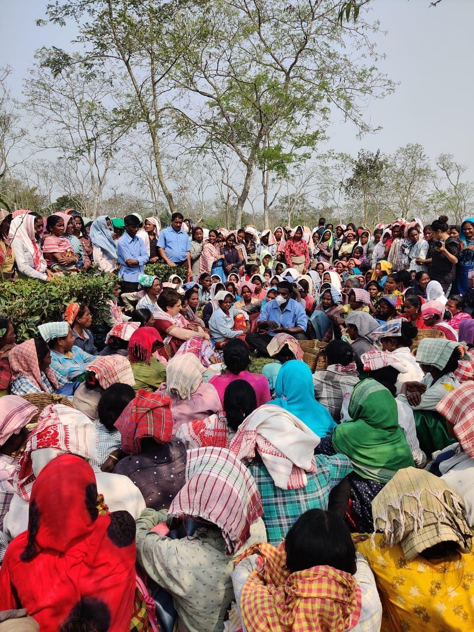 Priyanka Gandhi Vadra sitting with tea garden workers at Sadhuru tea garden, Biswanath, Assam.