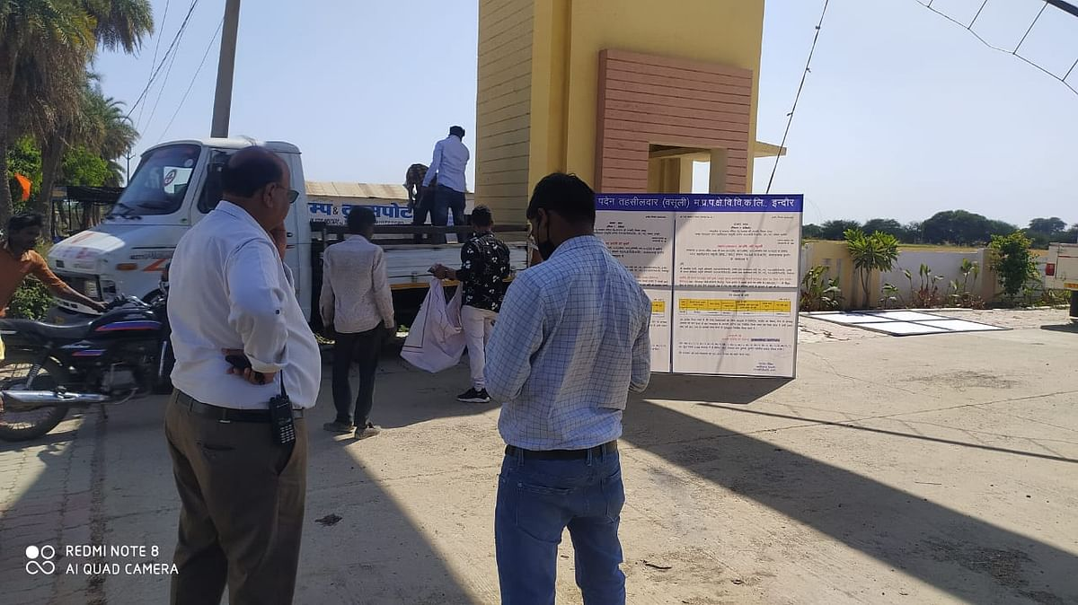 West Discom employees in presence of tehsildar sealing under-construction township.