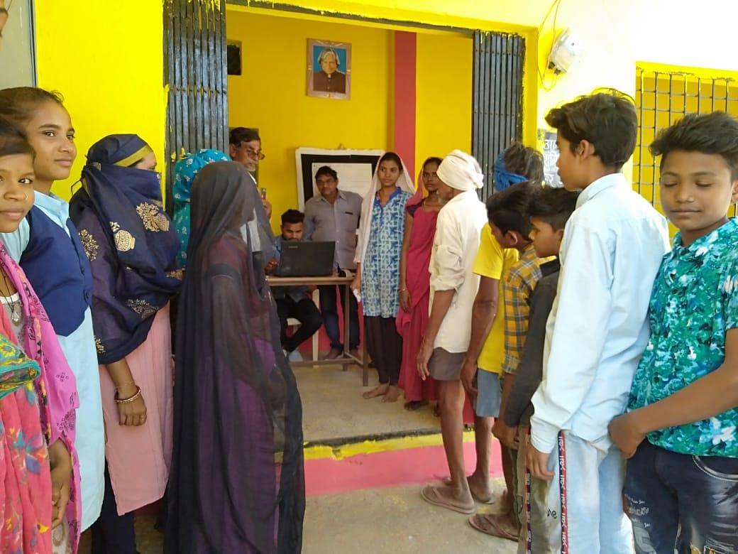 Tribals at Ayushman card camp in Dahi on Saturday