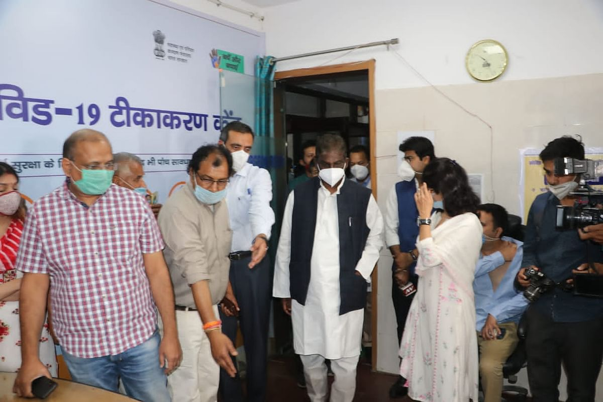 State health minister Prabhuram Choudhary walks into JP Hospital for vaccination in Bhopal on Monday