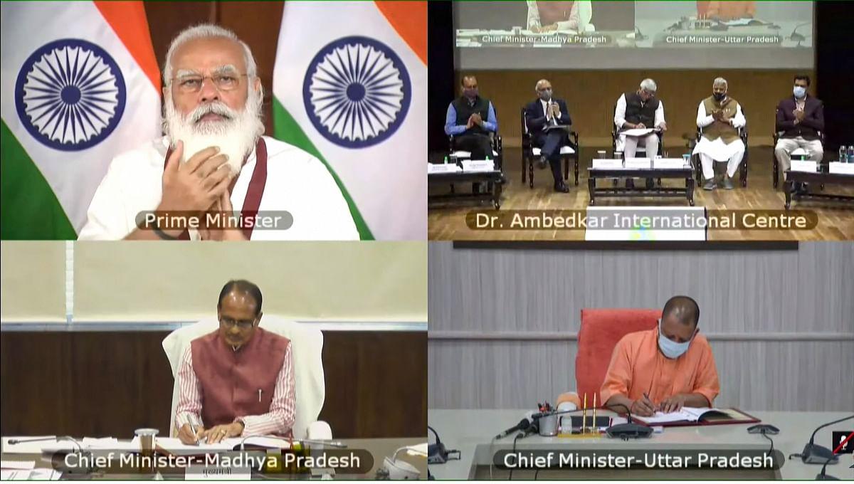 Prime Minister Narendra Modi during launch of 'Catch the Rain' campaign, via video conferencing, in New Delhi on Monday. MP CM Shivraj Singh, UP CM  Yogi Adityanath also seen
