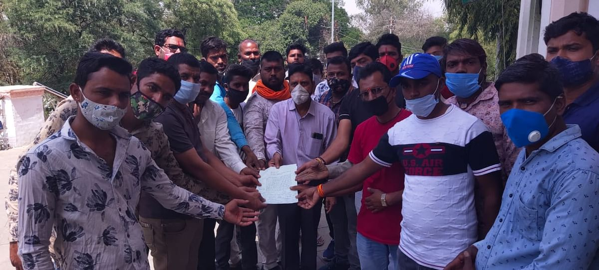 Affected farmers hand over a memorandum to a government officer