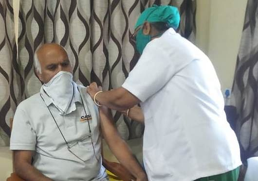 Ravi Kumar Jain, 65, was the first person to be vaccinated at MY Hospital corona vaccination centre in Indore on Monday