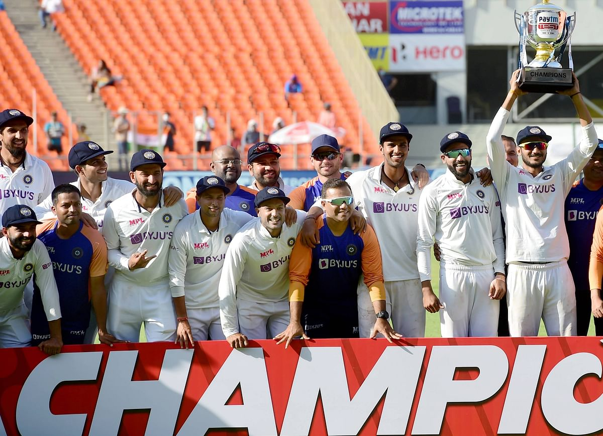 Indian players hold the torphy after defeating England in the 4th and last Test match in Ahmedabad on Saturday.